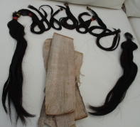 Real hair pieces for fringe and side of cheek and Yu tree bark for glue preparation