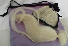 White hair top knot and horsehair cap