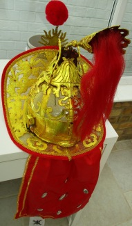 Mulan helmet back view with cloth wind-shield